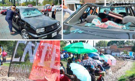 Enfrentamiento de maestros en Michoacán deja seis heridos y un hotel incendiado